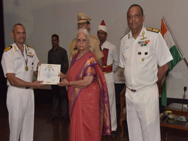 Governor Sinha presenting certificates to the officers