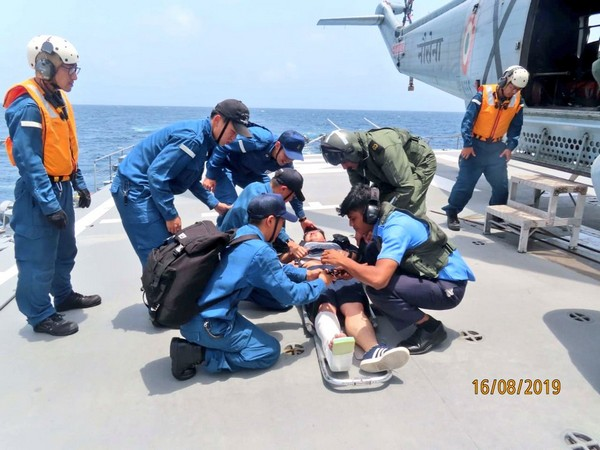 A Japanese crew member given medical attention by a medical team from Indian Navy off Mumbai on Friday. (Photo Credits: Navy Twitter)