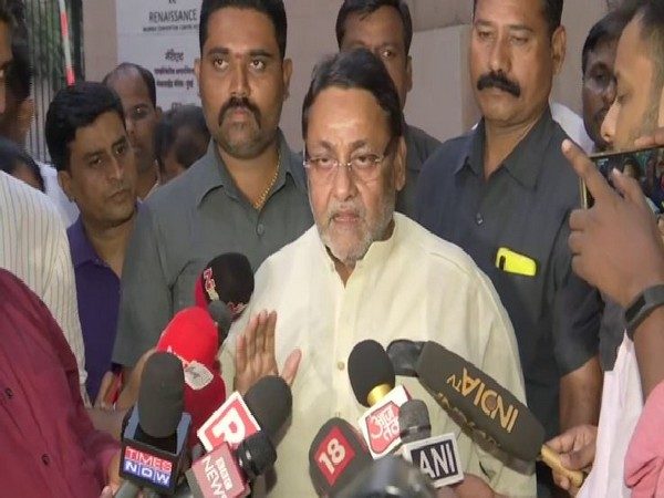 NCP leader Nawab Malik speaking to reporters in Mumbai on Sunday. Photo/ANI