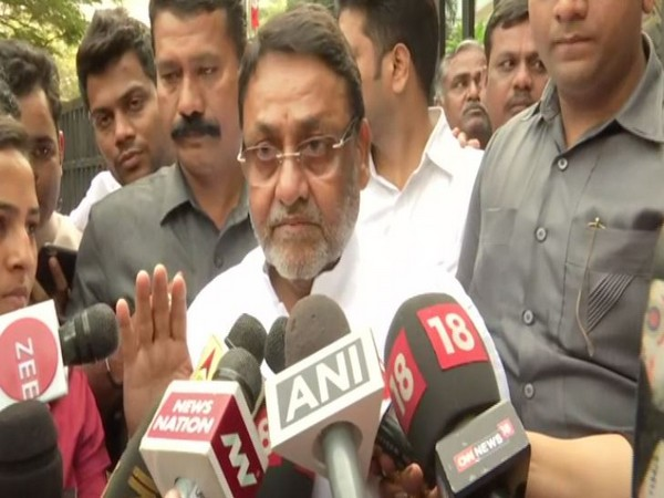 NCP leader Nawab Malik speaking to reporters in Mumbai on Tuesday. Photo/ANI