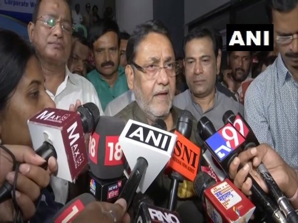 NCP leader Nawab Malik talking to media persons after the party meeting in Mumbai on Saturday evening.