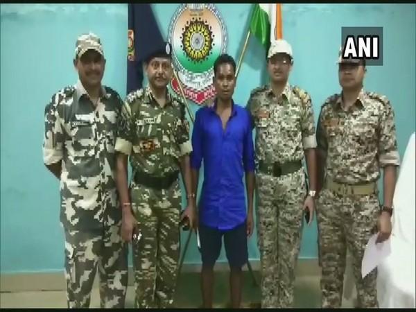 Naxal deputy commander Muchaki Budra surrenders before security forces in Dantewada, Chhattisgarh on Sunday.