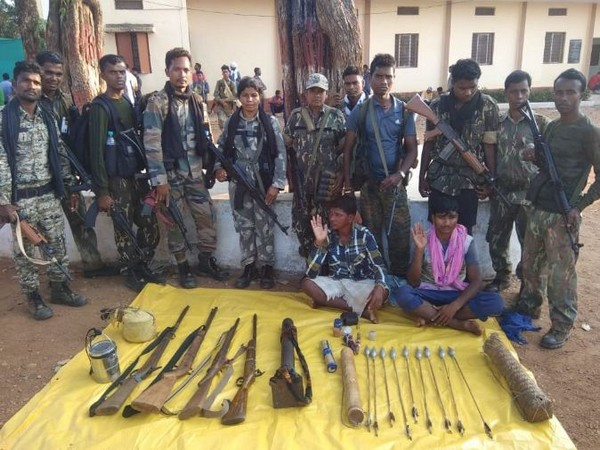 DRG personnel with the two Naxals and the arms that were seized after the exchange of fire on Monday. Photo/ANI
