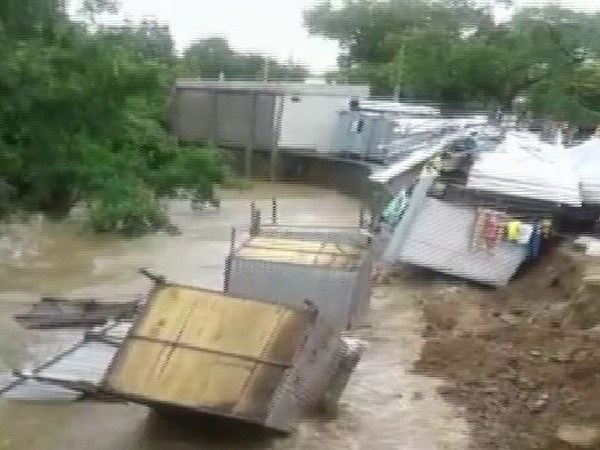 Multiple shops collapsed instantly into a canal in Neemuch district on Friday. Photo/ANI