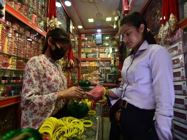 Shops bear a deserted look this Shrawan amid coronavirus pandemic. Photo/ANI