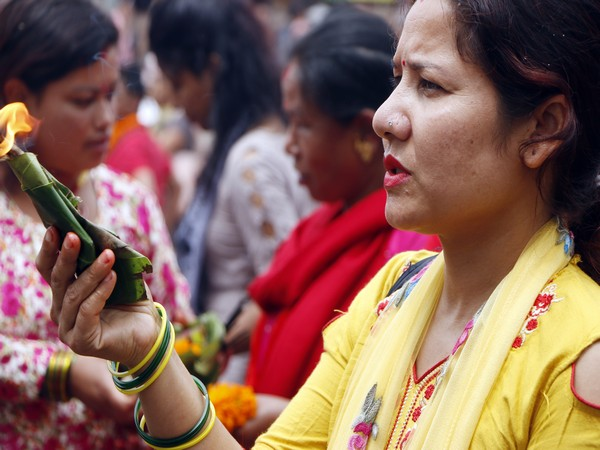 A woman offers prayers on the last day of Shravan in Nepal