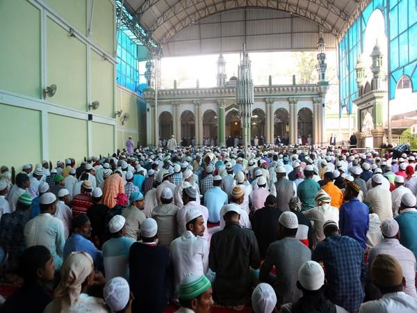 Members of the Muslim community congregate to mark the festival of Eid-ul-Fitr in Kathmandu, Nepal