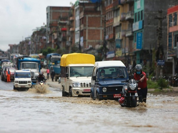 Vehicles struggle to get through a undaunted road section in Kavrepalanchok District of Nepal on July 9th, 2021. (ANI)