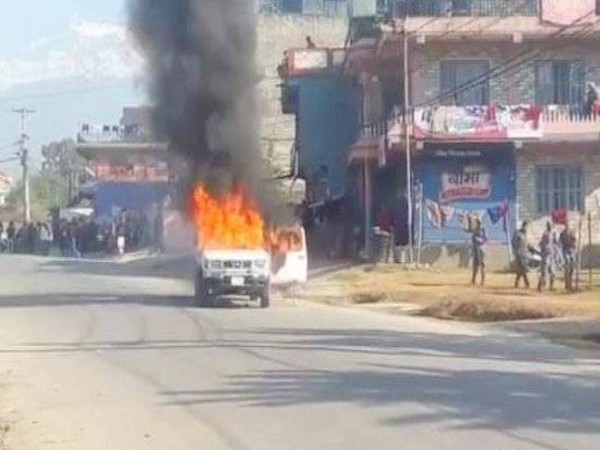 A vehicle on fire in Nepal on Wednesday
