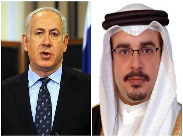 Israeli Prime Minister Benjamin Netanyahu (L) and Bahrain's Crown Prince Salman bin Hamad Al Khalifa (R)