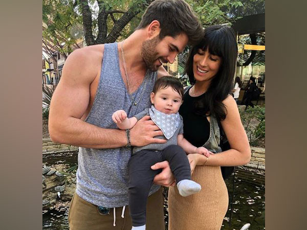 Nick Bateman and Maria Corrigan with their child (Image courtesy: Instagram)