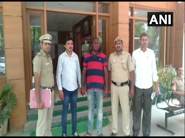 Visuals of police officer with the arrested accused in New Delhi.