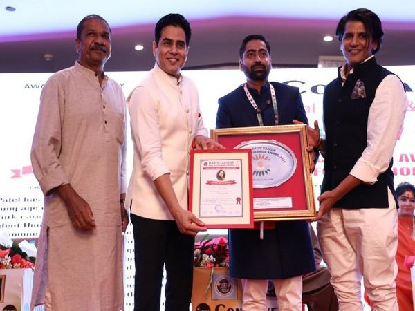 Niket Patel being honoured with