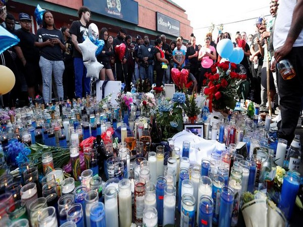 People gather around a makeshift memorial for Grammy-nominated rapper Nipsey Hussle who was shot and killed outside his clothing store in Los Angeles, California, U.S., April 1, 2019. REUTERS