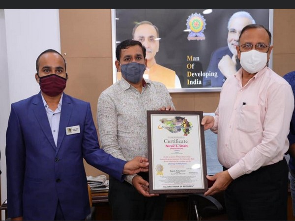 Nirav Shah receives GUJARAT BOOK OF RECORD for planting 70000 trees on the occasion of PM Narendra Modi's birthday