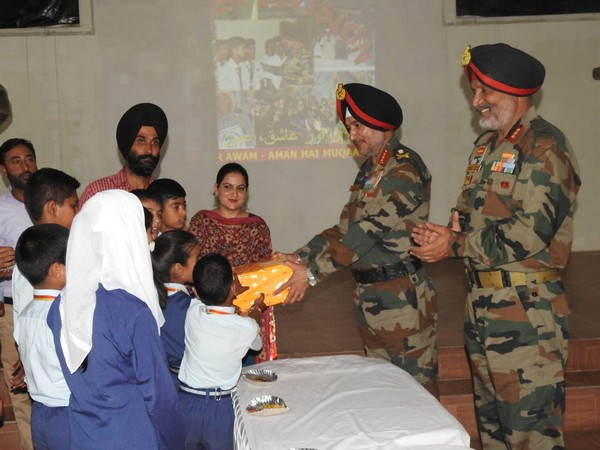 Lt Gen Ranbir Singh, General Officer Commanding-in-Chief of Northern Command interacting with kids in North Kashmir on Tuesday. (Photo/ANI)