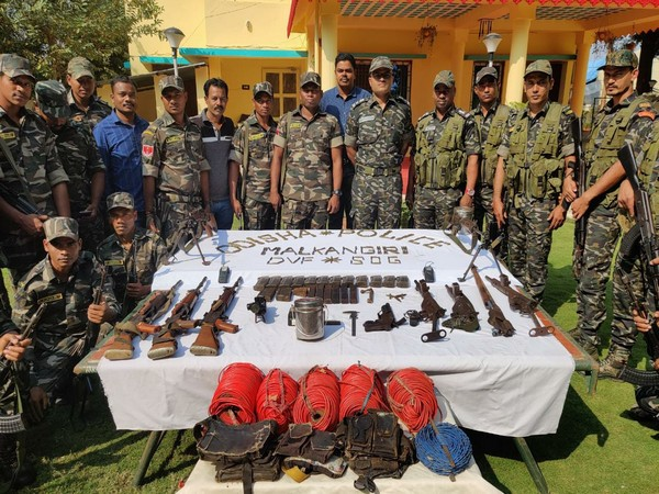 Security forces with arms and ammunition seized from Naxals