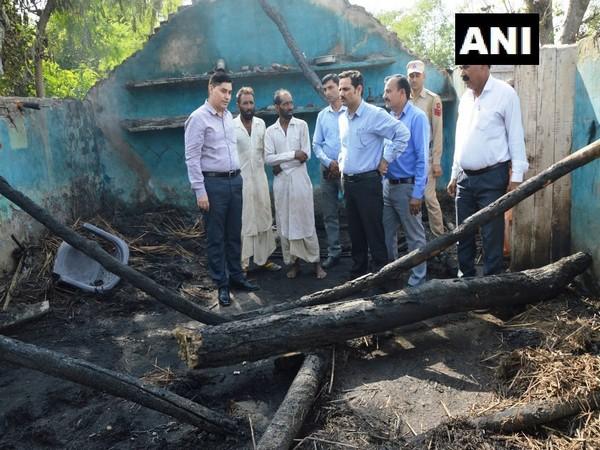 Kathua Deputy Commissioner O P Bhagat inspecting damages caused due to cross border firing on Sunday. Photo/ANI
