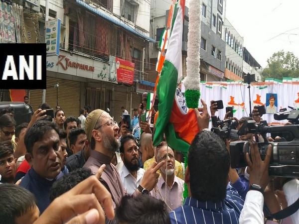 AIMIM chief Asaduddin Owaisi hoisting the flag on Thursday in Hyderabad. Photo/ANI