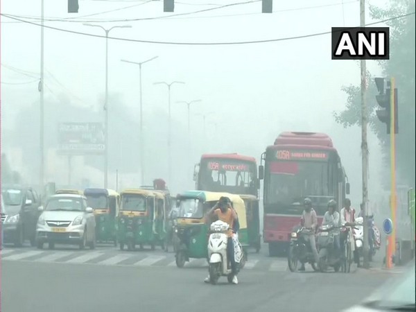 Vehicles waiting at the ITO red light as a layer of smog blankets the area on Monday morning.
