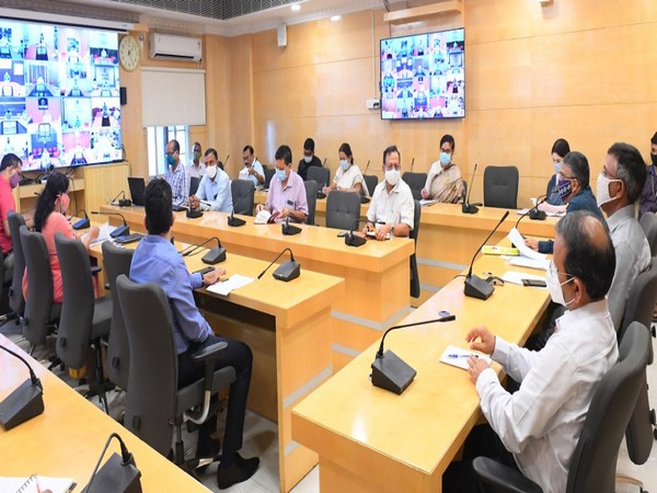 Odisha Chief Secretary Asit Tripathy conducts a district-wise review of the COVID-19 situation. Photo/ANI
