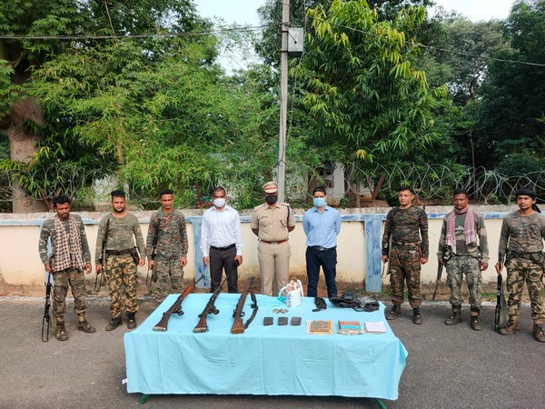 Security forces displaying the recovered arms and ammunition in a joint operation on Wednesday. (Photo/ANI)