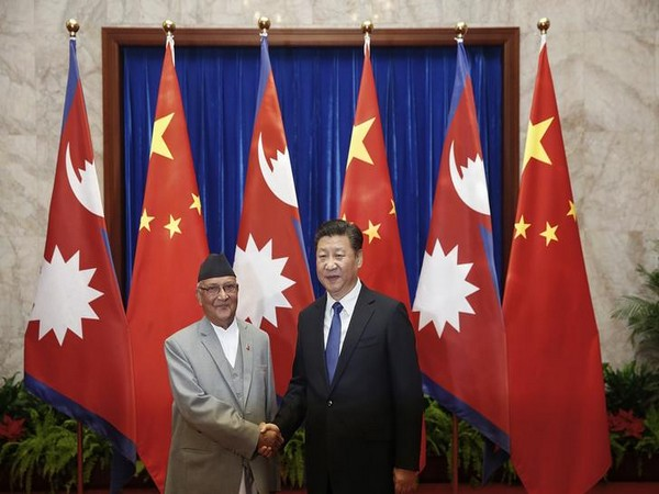 Nepal Prime Minister KP Sharma Oli (L) and Chinese President Xi Jinping (R).