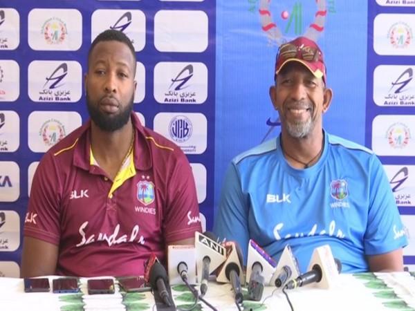 West Indies skipper Kieron Pollard (L) and coach Floyd Reifer (R)