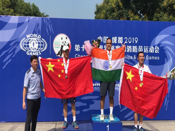 AIG Ashish Kapoor on the victory stand after winning gold medals during World Police and Fire Games at Chengdu, China.
