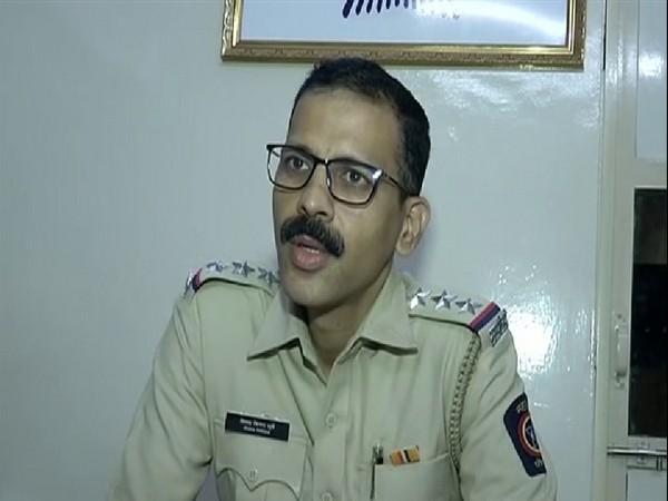 Police Inspector Deepak Vijay Surve talking to reporters on Friday. Photo/ANI
