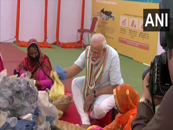 Prime Minister Narendra Modi meets women who pick plastic from garbage and extends a helping hand to them in Mathura [Photo/ANI]