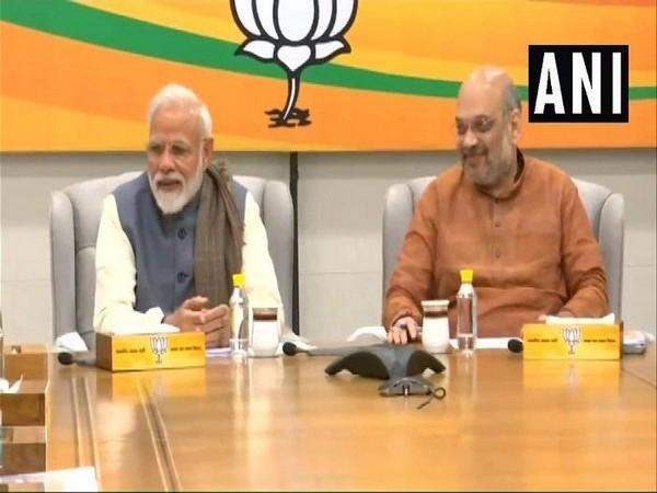Narendra Modi (L) and Amit Shah (R) [File photo]