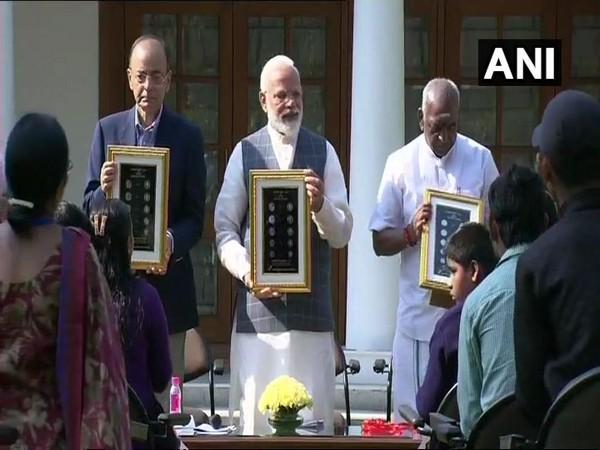 Prime Minister Narendra Modi, Finance Minister Arun Jaitley and MoS Finance Pon Radhakrishnan releasing visually-impaired friendly series of coins on Thursday.