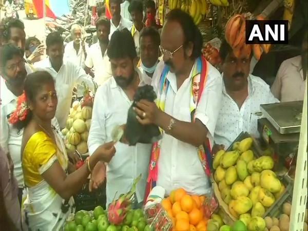 Pattali Makkal Katchi (PMK) candidate AVA Kasali selling mangoes in Chennai on Saturday.