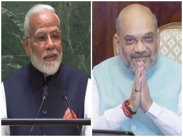Prime Minister Narendra Modi (left) and Home Minister Amit Shah (right).