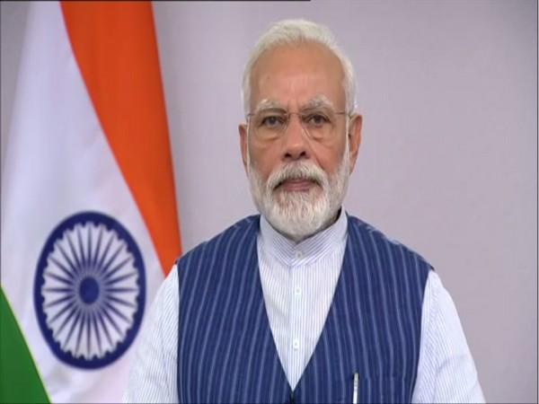 Prime Minister Narendra Modi addressing people of his Lok Sabha constituency, Varanasi, via video conferencing, on Wednesday.