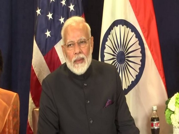 Prime Minister Narendra Modi speaking to reporters during a bilateral with President Trump