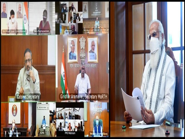 Prime Minister Narendra Modi interacting with officials via video conference.