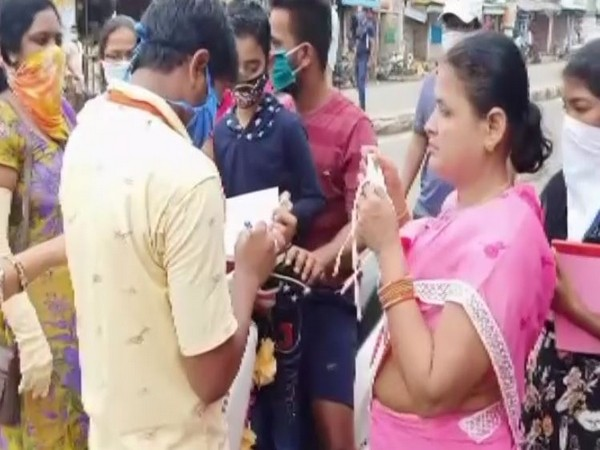 ASHA workers in Etcherla, Andhra Pradesh fine people for not wearing masks on Thursday. (Photo/ANI)