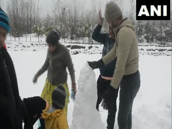 Tourists enjoy snowfall in Pahalgam
