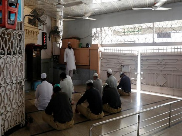Muslims gather to attend Friday prayers after government limits congregational prayers and ordered people to stay home