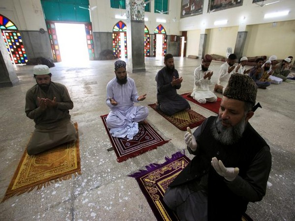 Prayers being held in a mosque in Pakistan with social distancing.