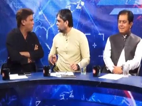 Imtiaz Khan Faran (extreme left) and Masroor Ali Siyal (middle) seen engaging in a heated debate at a TV talk show
