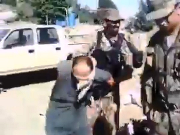 Video showing Pakistan Army personnel kicking a blindfolded man.