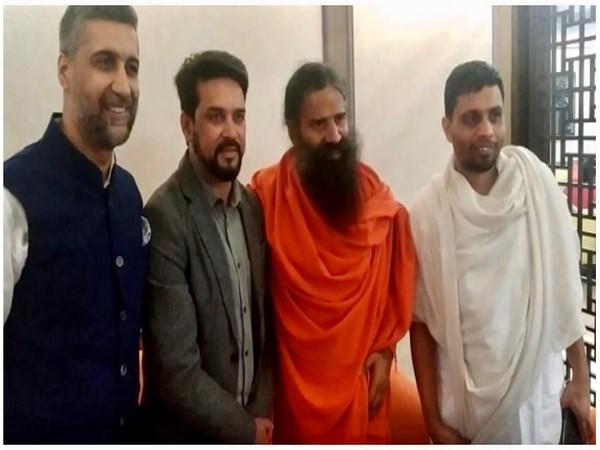 Nikhil Nanda, Hardeep Singh Puri, Swami Baba Ramdev, and Acharya Balkrishna