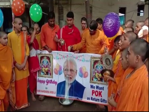 LJP workers offer milk in front of PM Modi poster