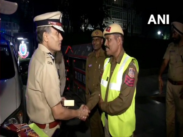 Delhi Police Commissioner Amulya Patnaik  meeting personnel deployed on duty on Diwali night. (Photo/ANI)