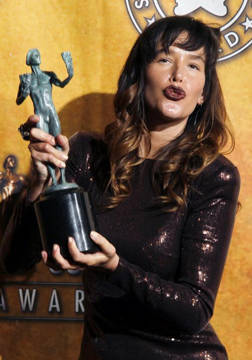 Actress Paz de la Huerta poses with her award for best ensemble in a drama series for HBO's