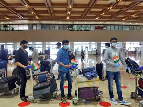 Stranded Indians in Manila before departure to Chennai and Visakhapatnam, on Tuesday.