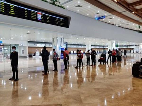 Passengers arrive at Ninoy Aquino International Airport in Manila on Sunday